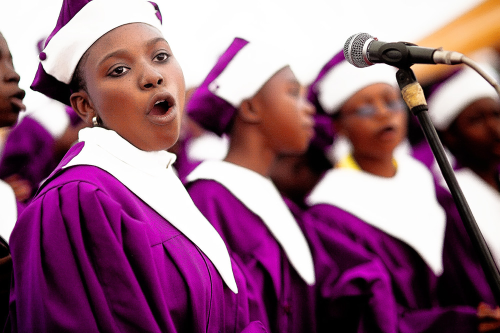 photoblog image A lady singing in the choir