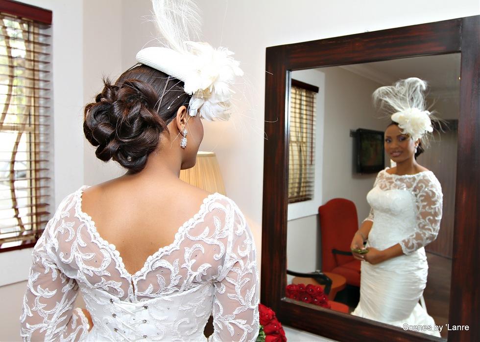 photoblog image Beautiful bride admires herself in the mirror