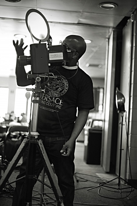 photoblog image With my large format Camera and My Versace Tee.