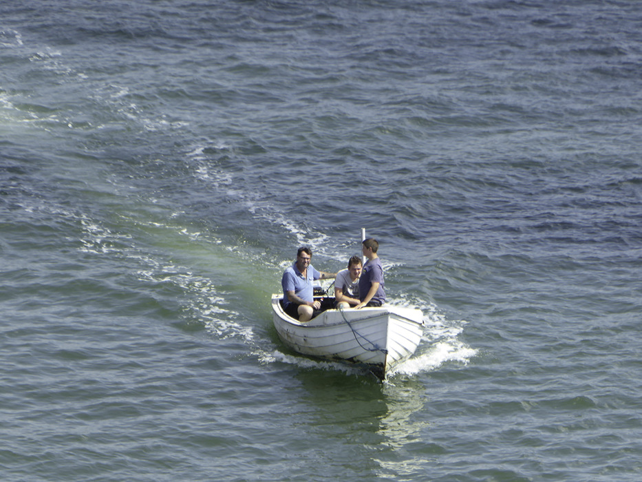 photoblog image Three men in a boat